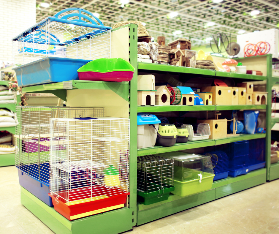 Small pet travel carriers and homes on display in pet shop.